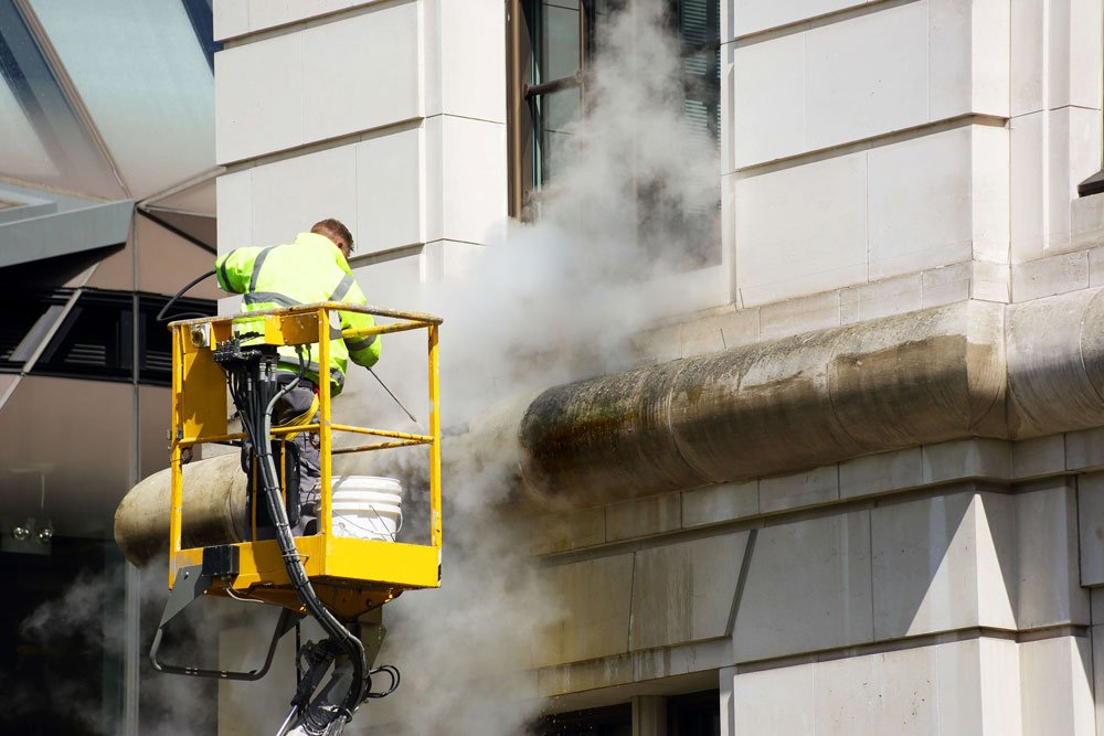 Facade cleaning using cherry picker