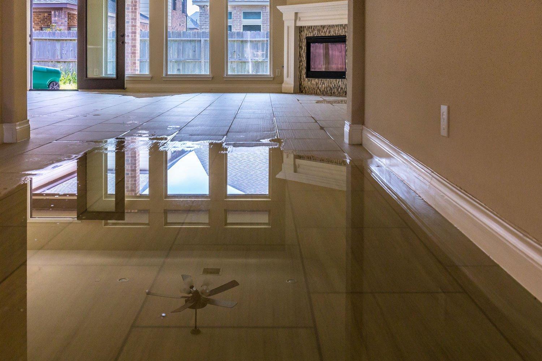 Standing water on tiled floor