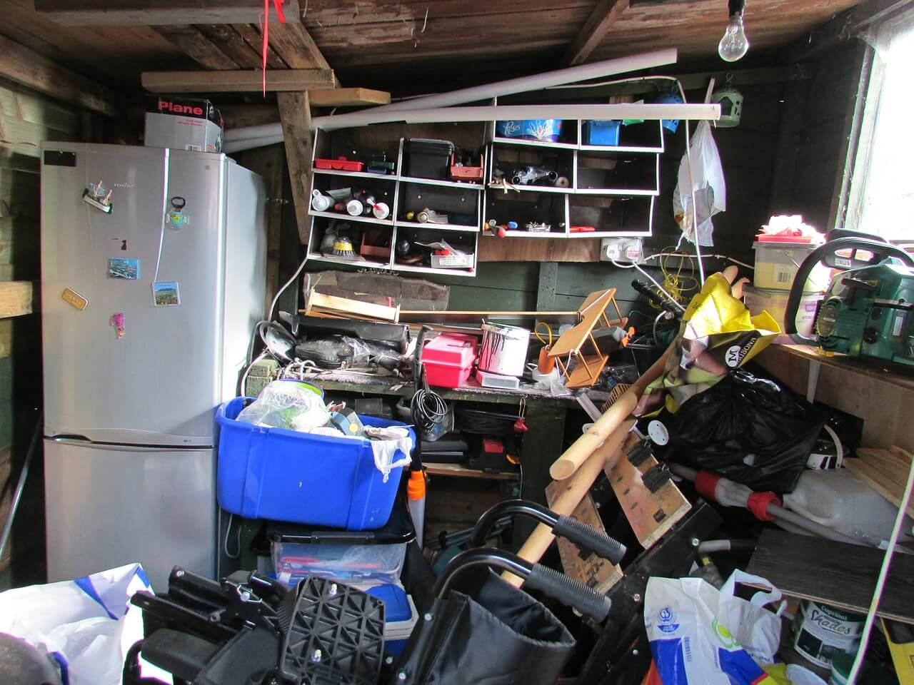Belongings piled up in a shed