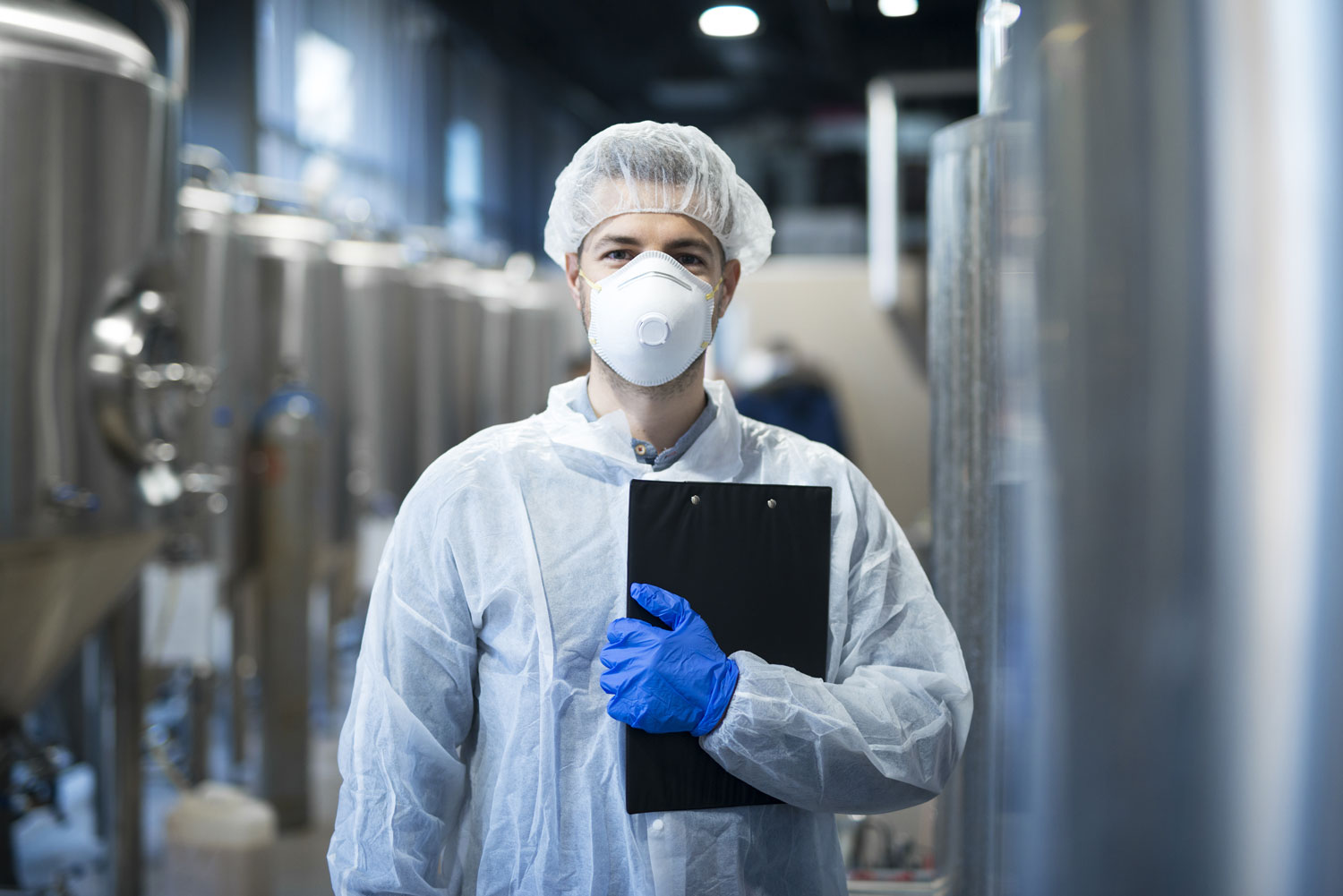 Man with clipboard in PPE