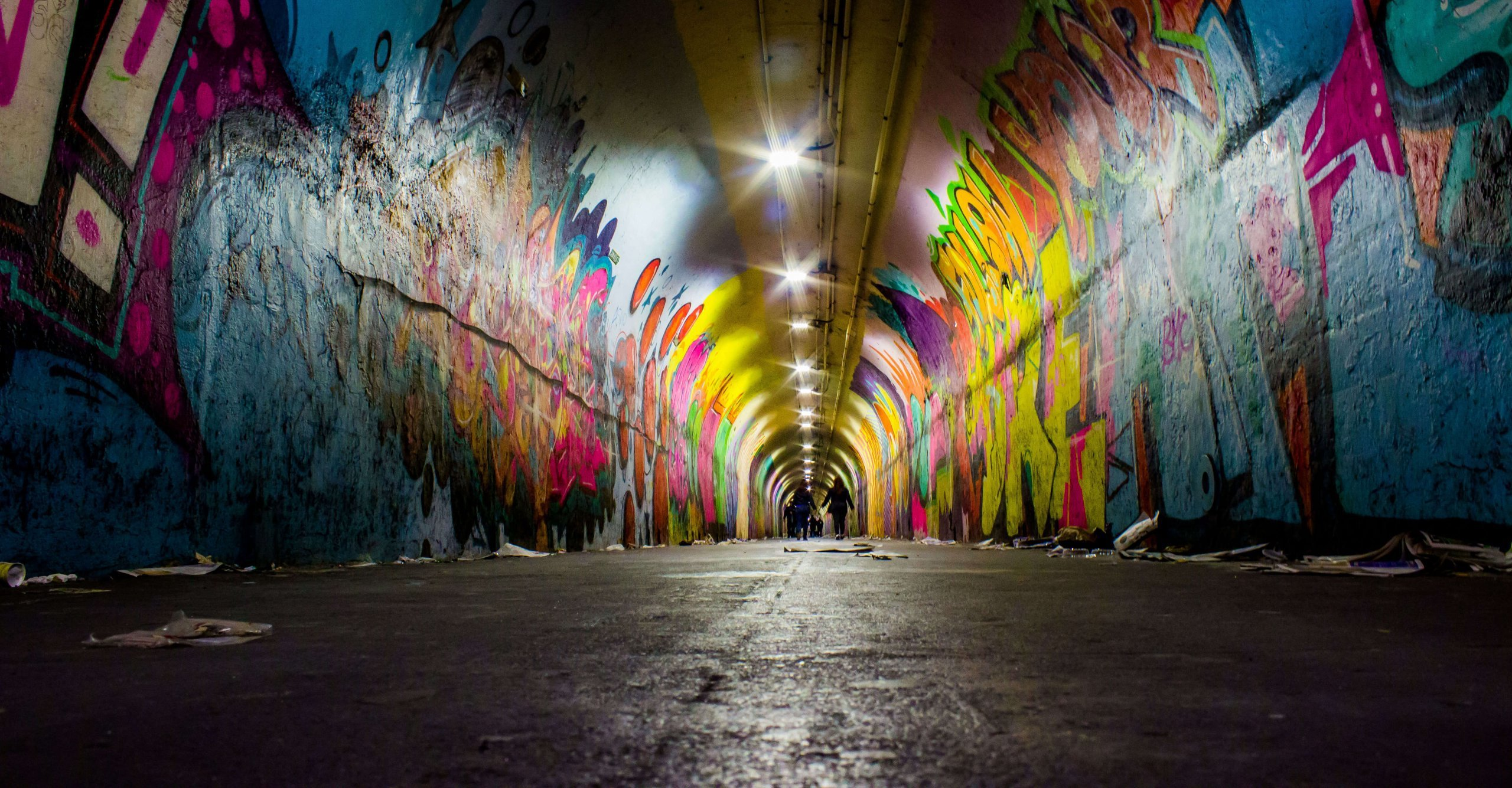 Graffiti covering the walls of a tunnel