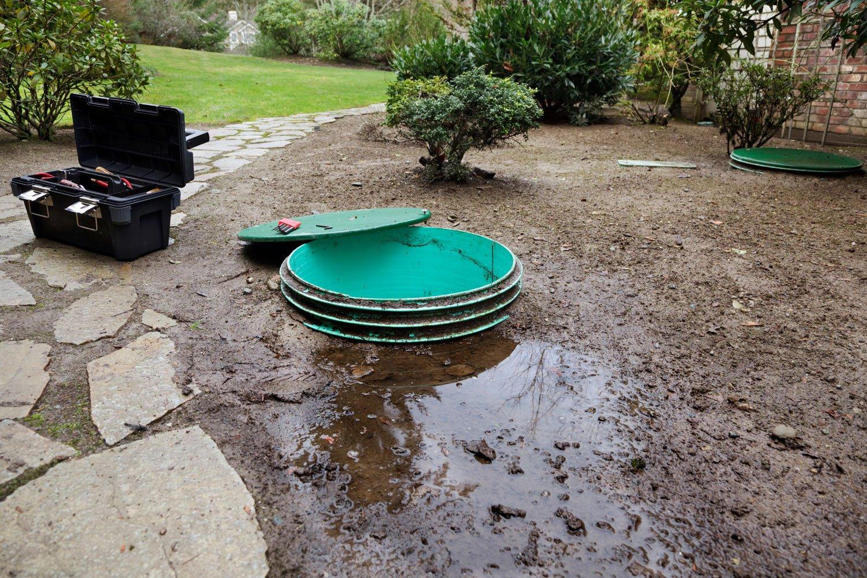Toolbox alongside open septic tank