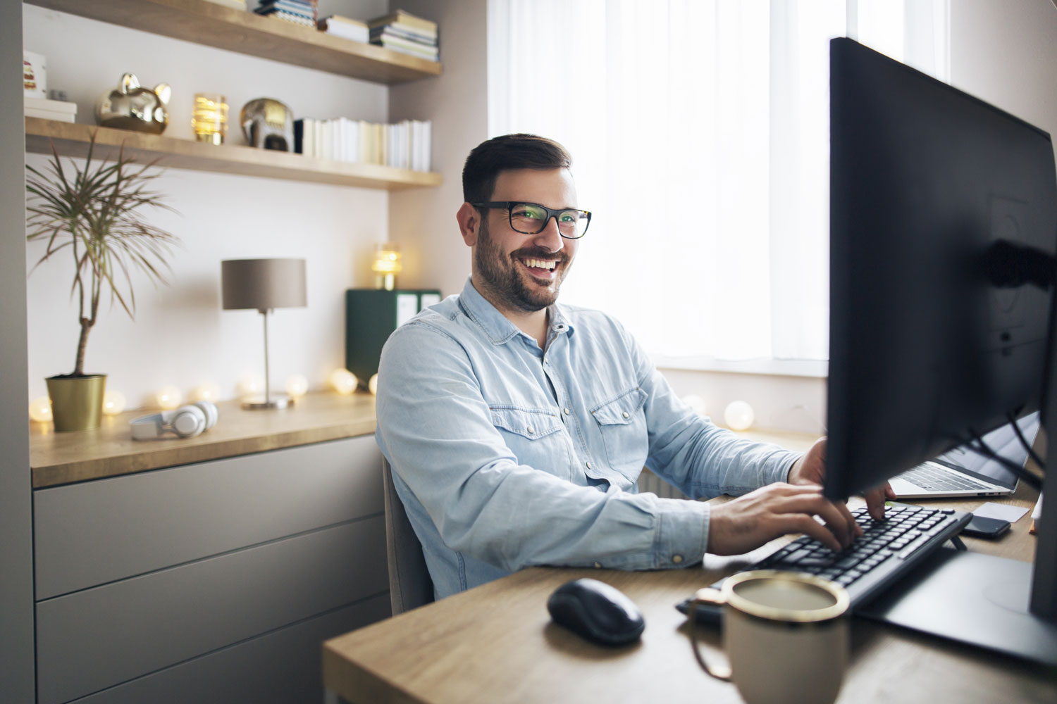 Man happily working from home office